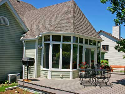 Sunroom_conservatory w/ Shingled, Victorian roof